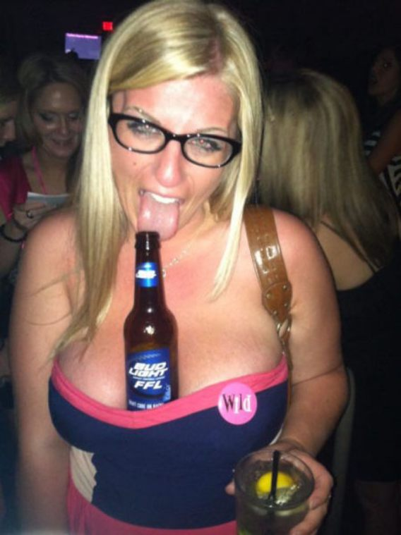 pic of Elle has a bottle of beer between her huge downblouse titties